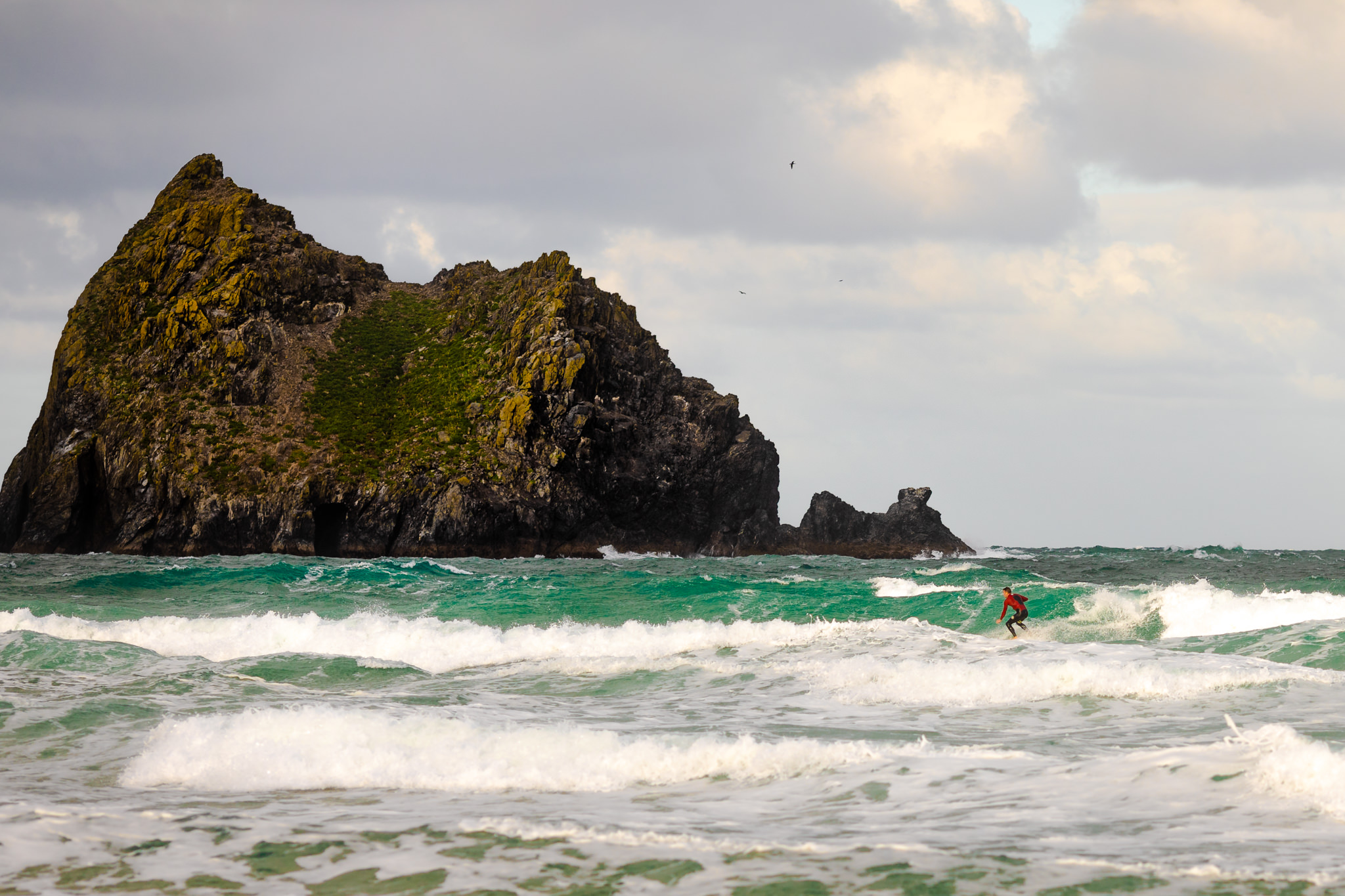 Holywell Bay in Cornwall surfing waves