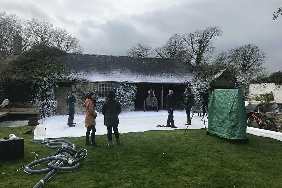 Artificial snow being set up for Celtic & Co photoshoot in Cornwall
