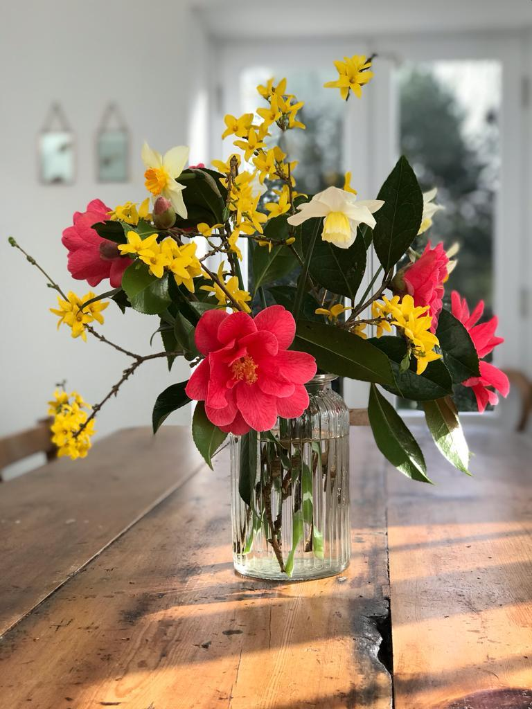 spring flowers from Cornish garden in vase on table