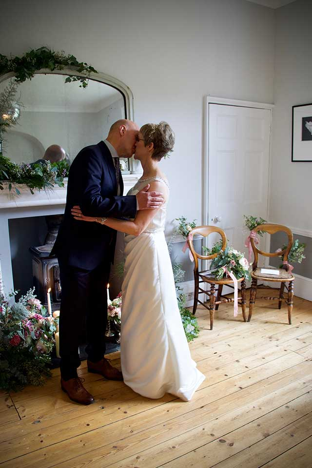 elopement wedding couple kiss after getting married