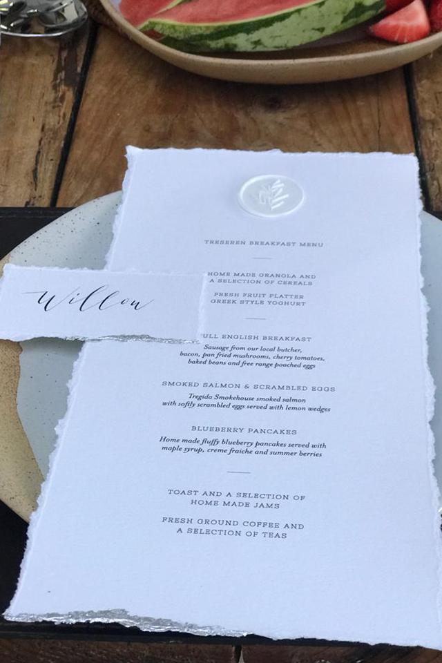 Calligraphy wedding breakfast menu on textured cream paper