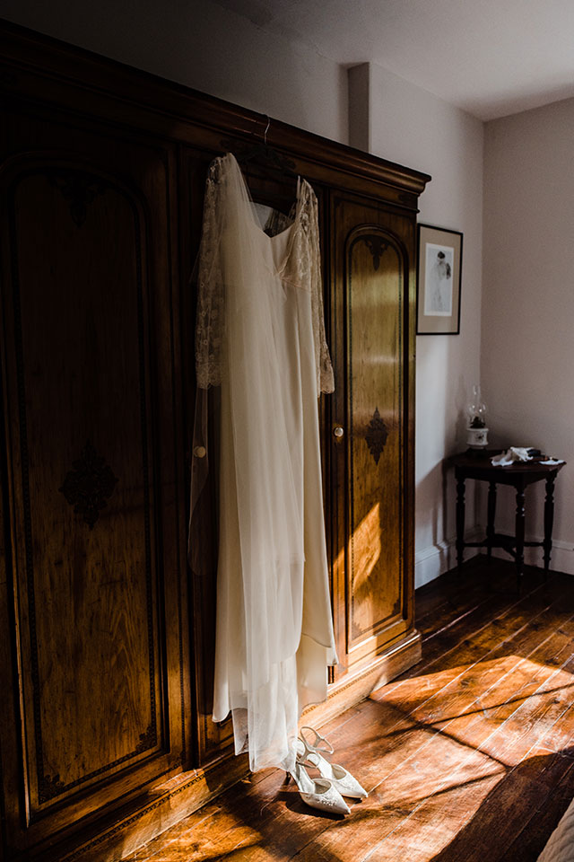 vintage wedding dress on wardrobe in country house