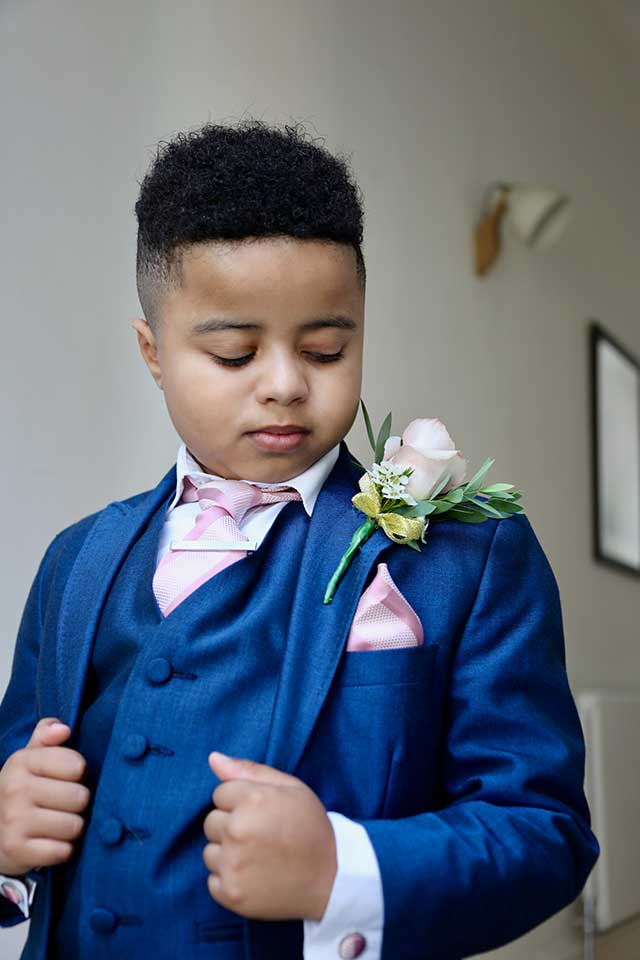 young boy wearing wedding suit
