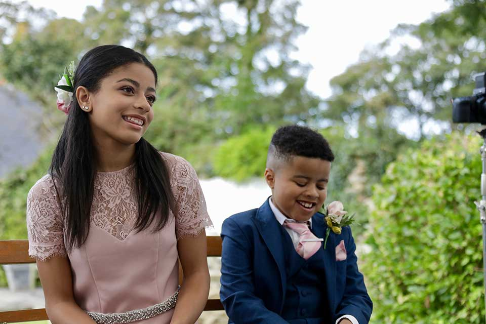 young wedding guests smiling