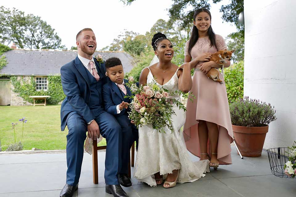 bride and groom and their 2 children on wedding day