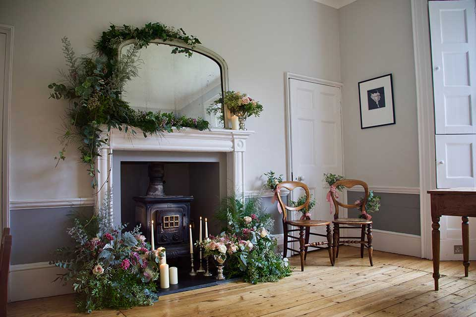 Drawing room set up with flowers for elopement wedding ceremony