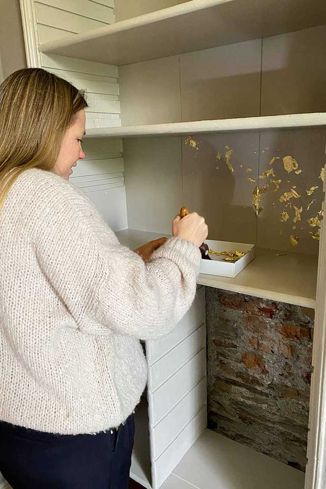 Emma from Treseren applying gold leaf to walls