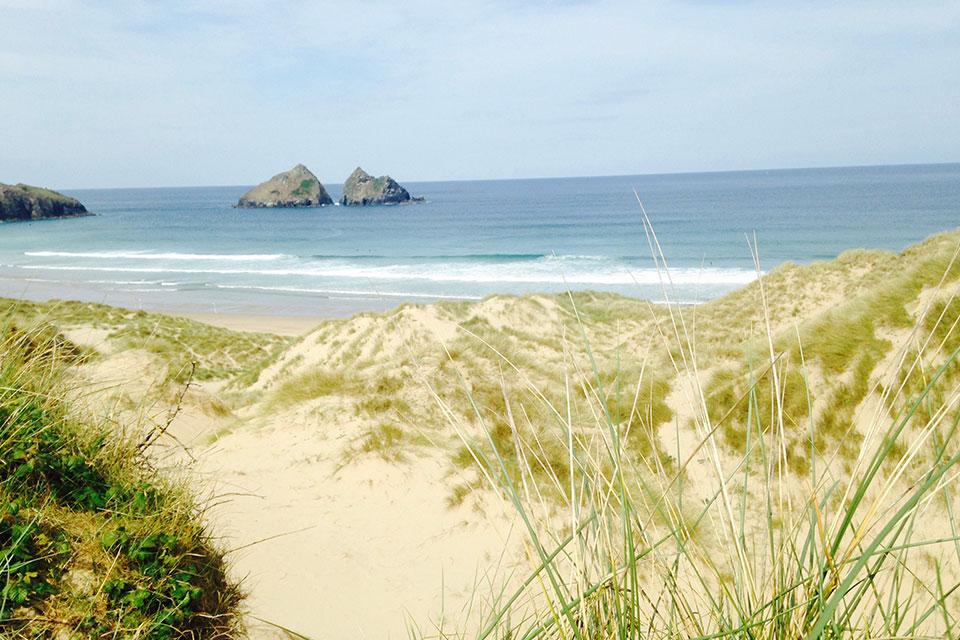 Holywell Bay Cornwall twin rocks from Poldark