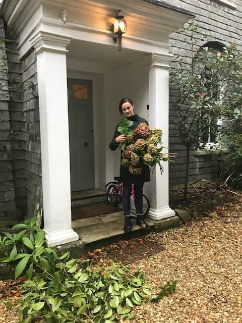Gathering flowers and foliage ready for the wedding venue shoot