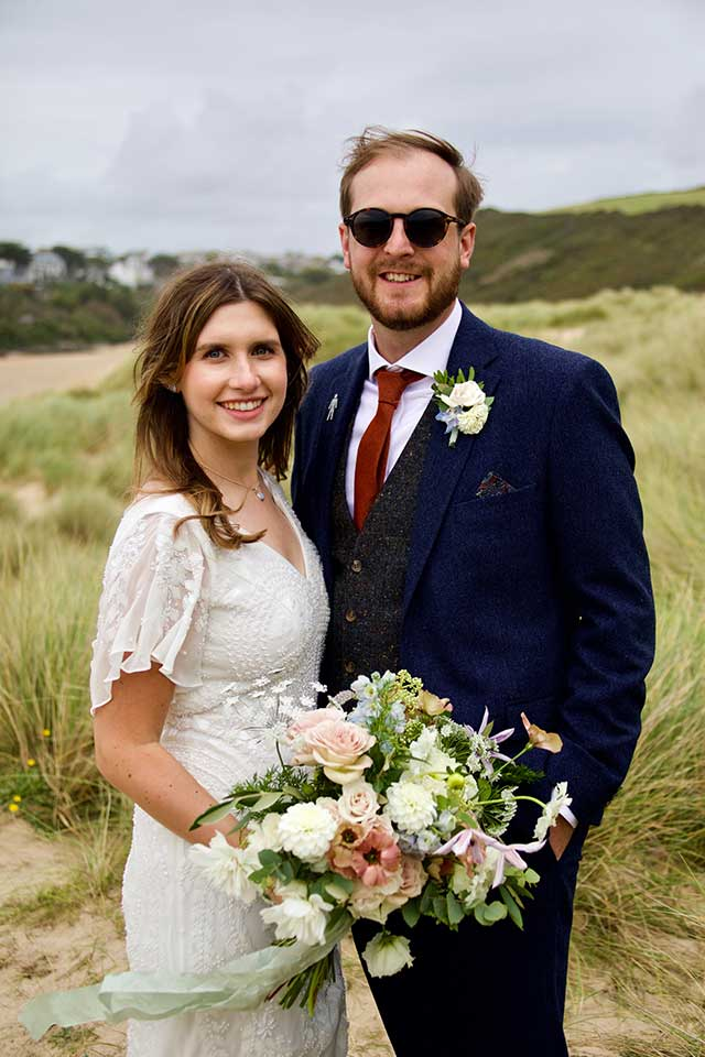 happy bride and groom on beach