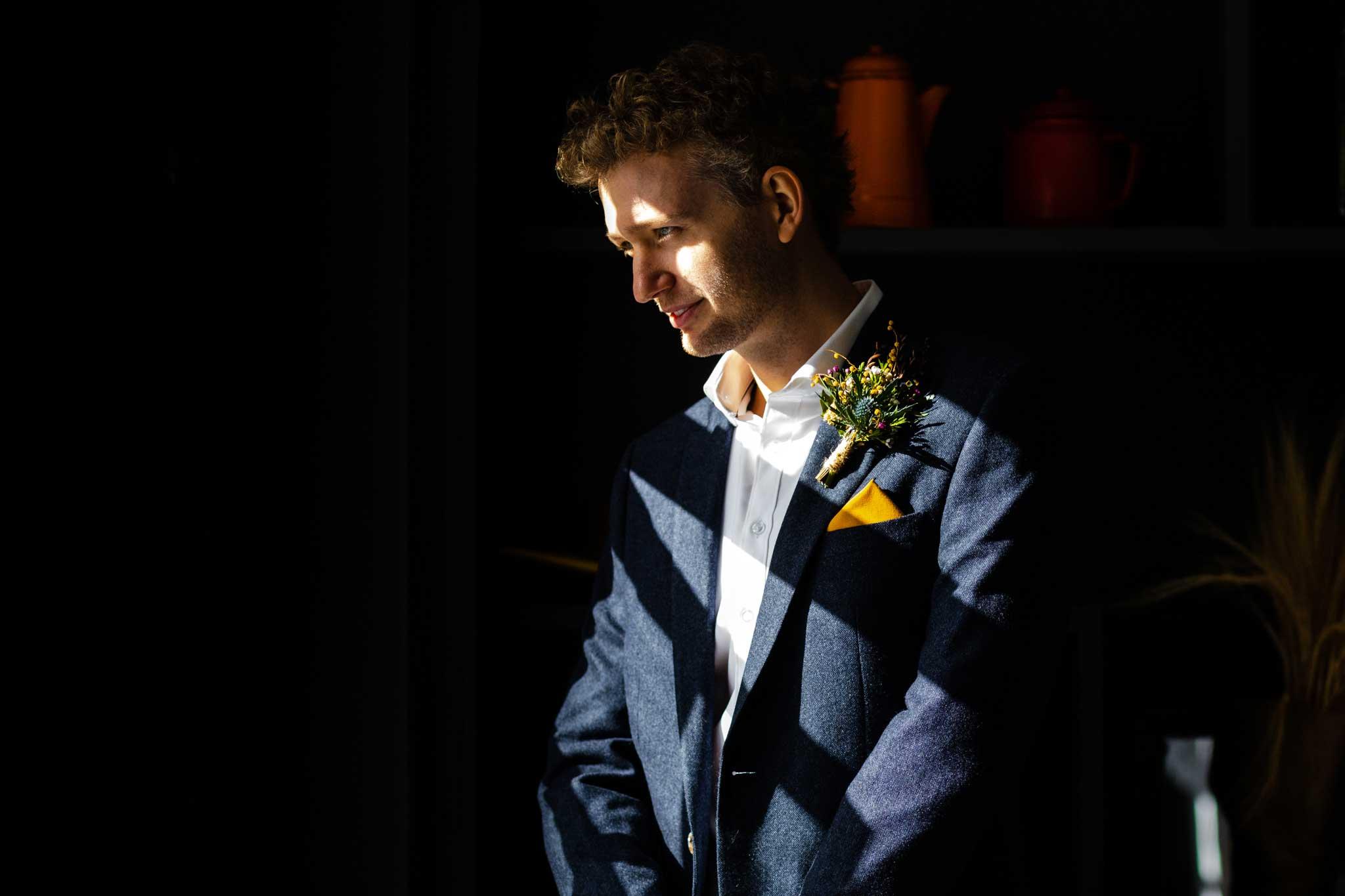 groom on wedding morning contemplative