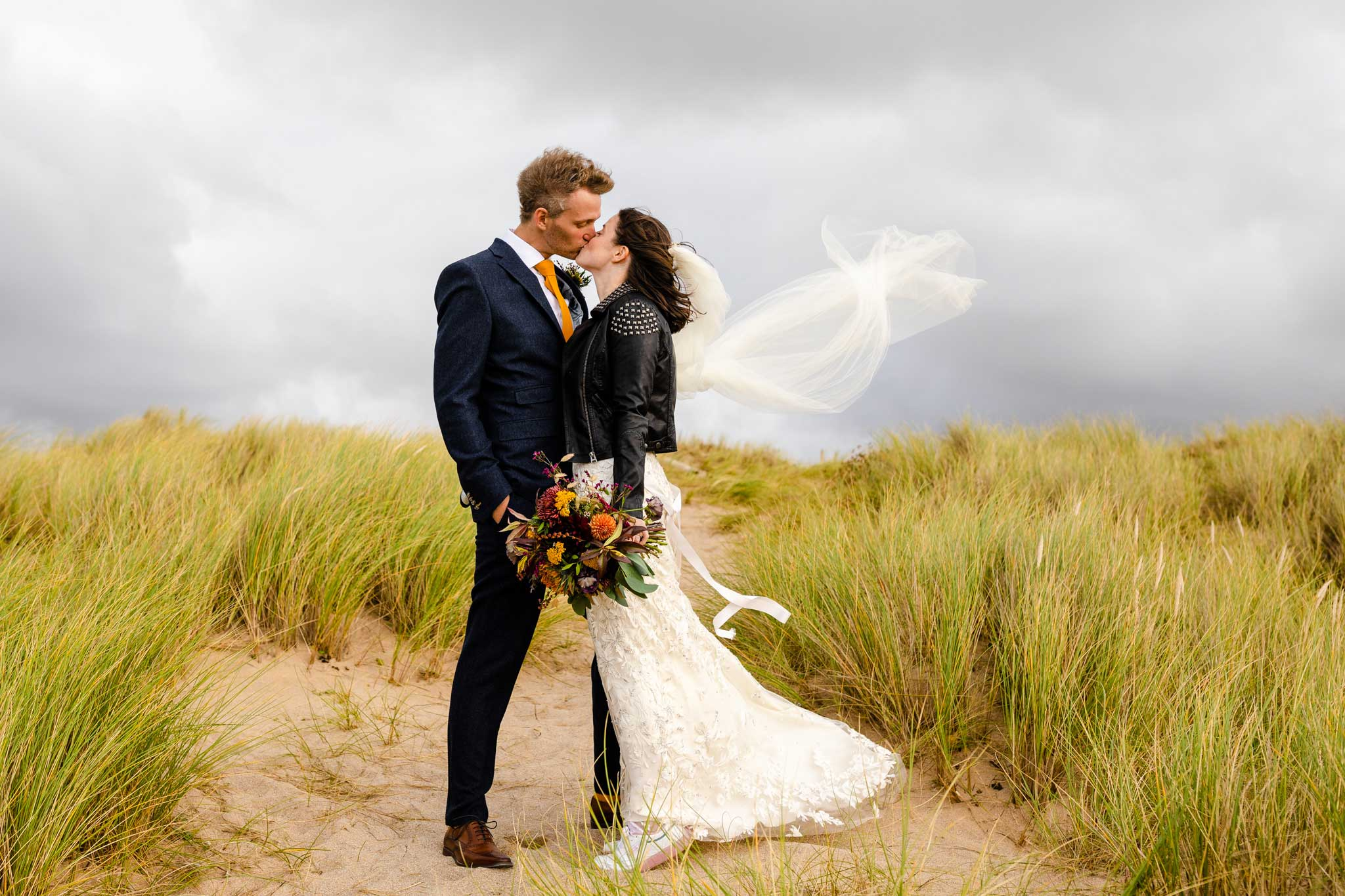 bride in leather jacket on beach
