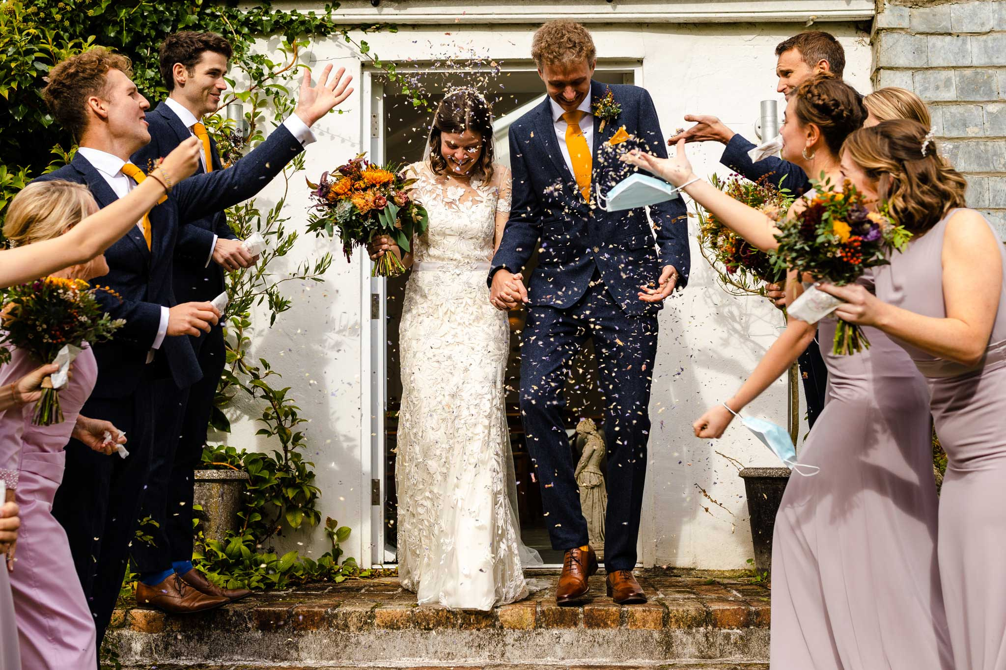 confetti moment on wedding day on steps