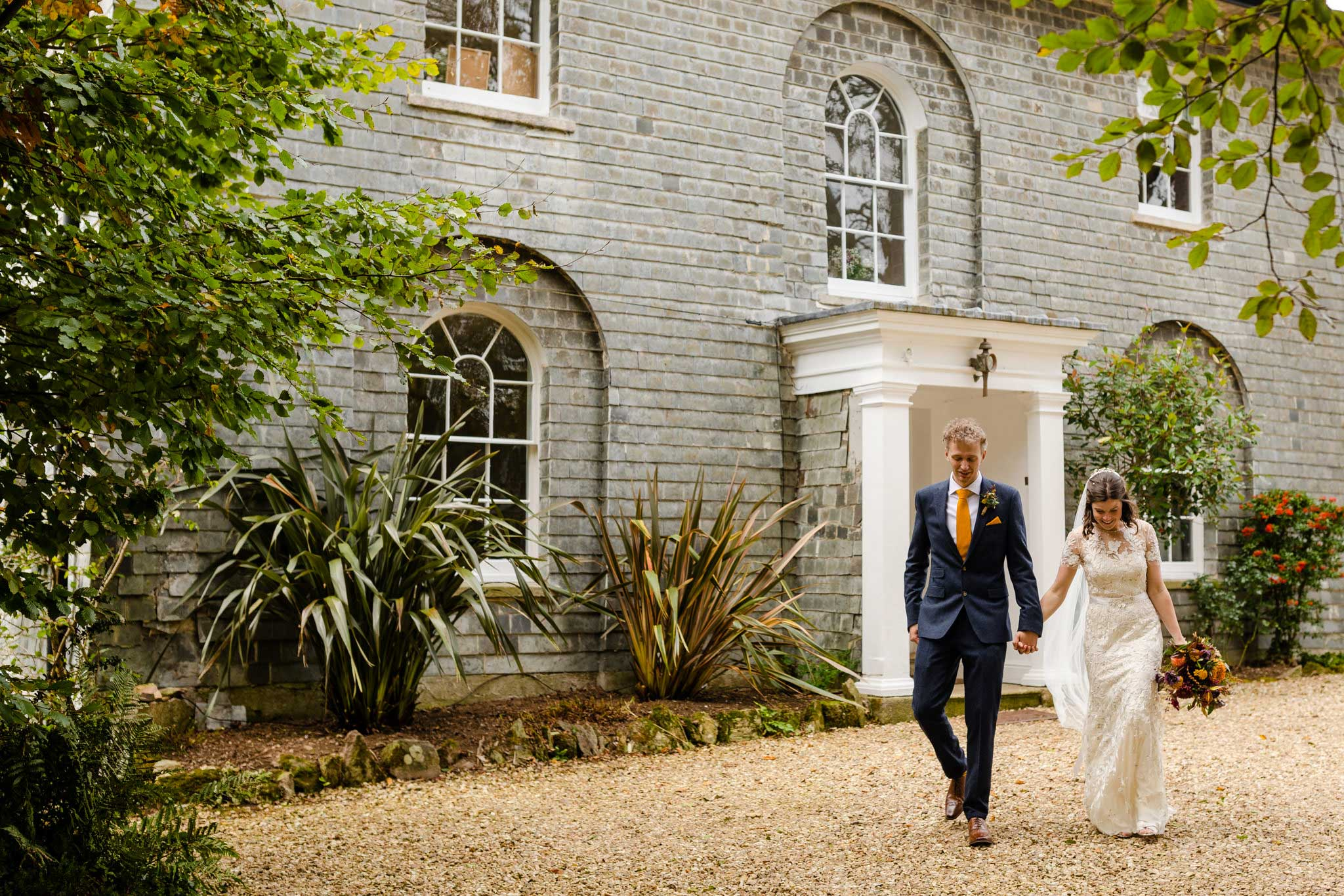 bride and groom outside country house wedding venue