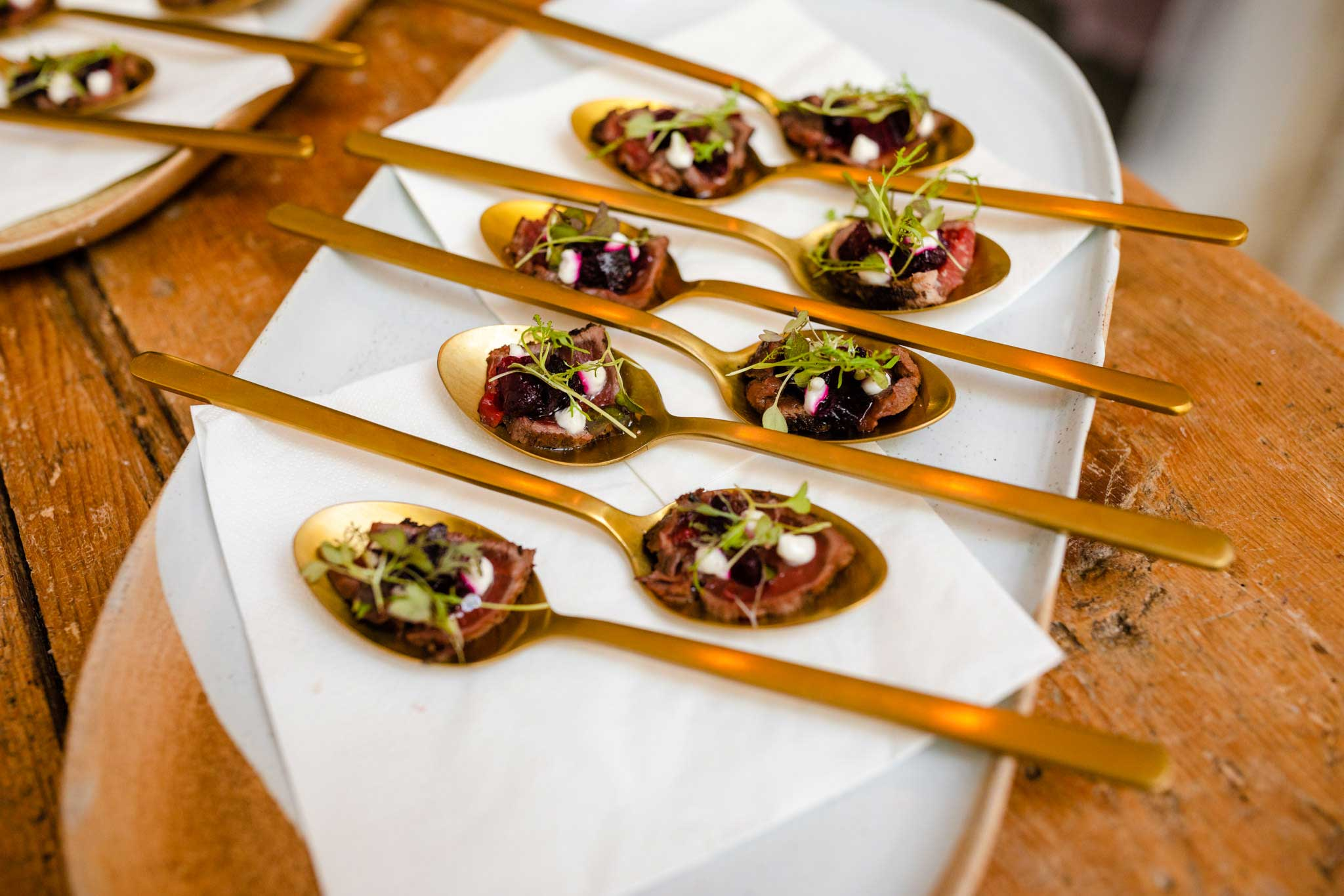 gold spoons with wedding canapes