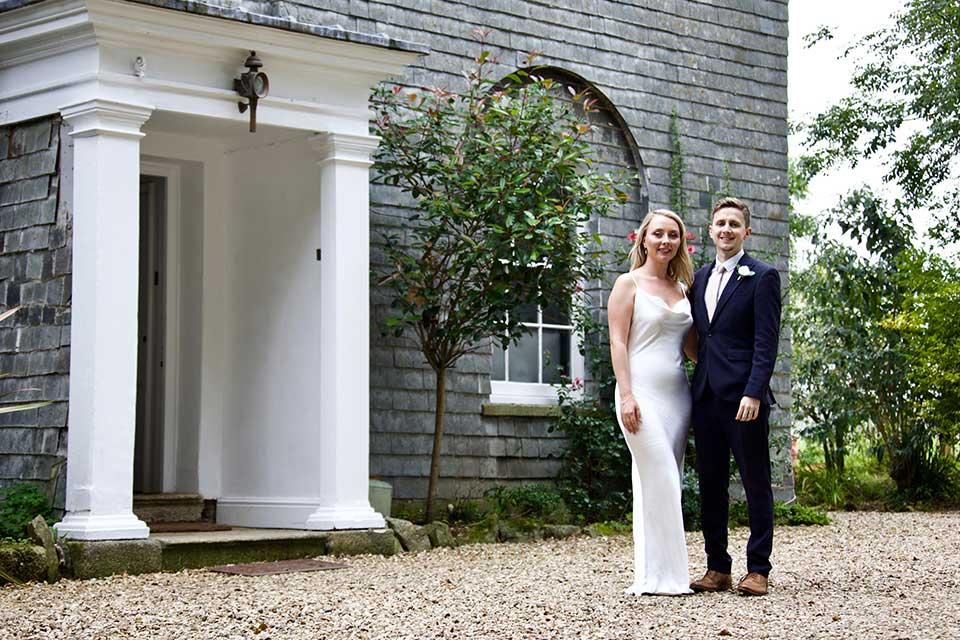 elopement wedding couple stood outside wedding venue Treseren