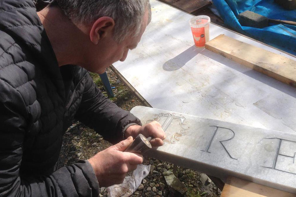Paul enjoying carving our logo into the marble sign