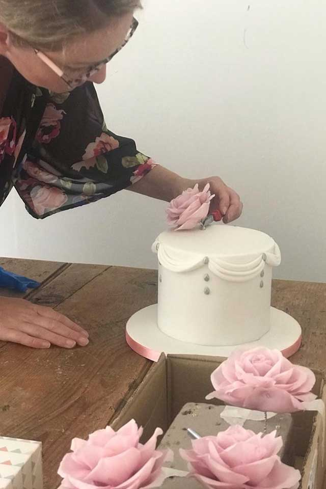 Sarah from The Cornish Cakery making pink rose sugar flowers