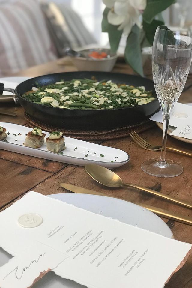Wedding table setting with vegan paella in large dish