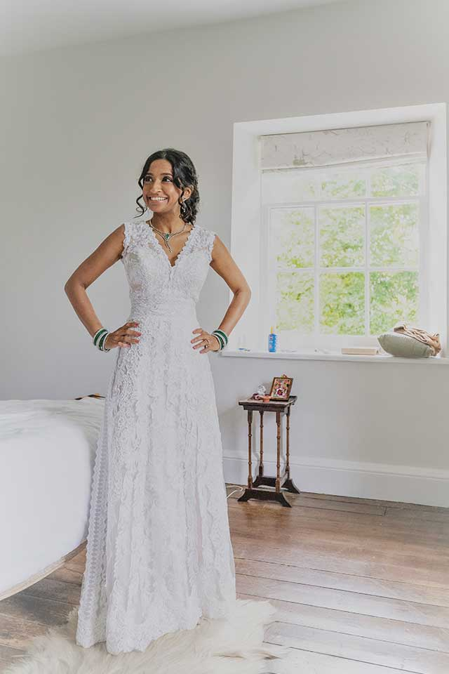 bride in lace wedding dress in bridal suite