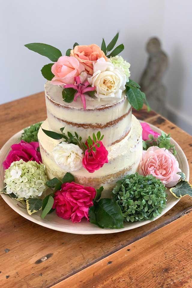 semi naked small wedding cake with fresh flowers
