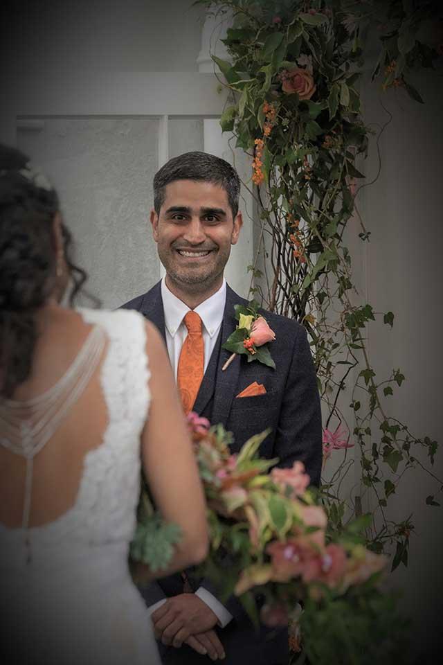 groom smiling at beautiful bride