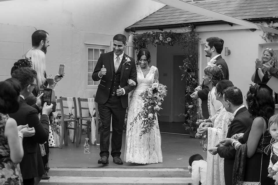 black and white image of wedding party at small Anglo-Indian fusion wedding
