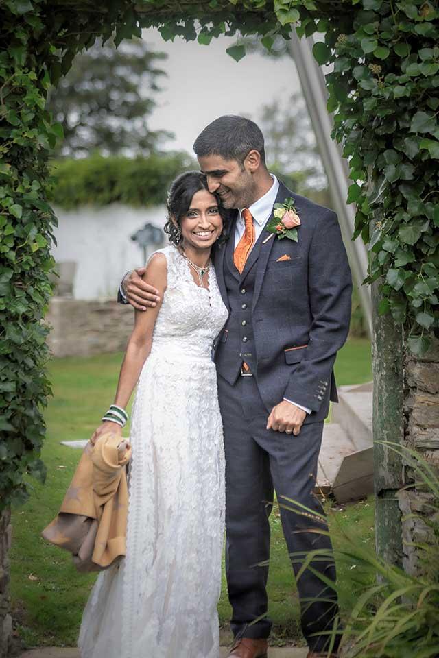 embracing bride and groom at Cornwall wedding