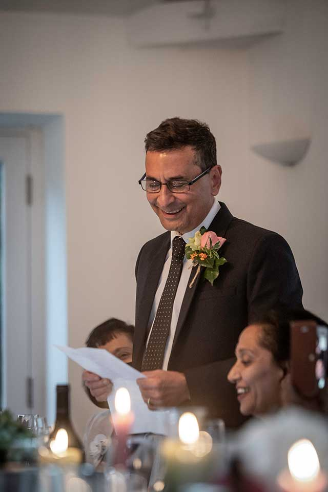 father of the bride reading his wedding speech