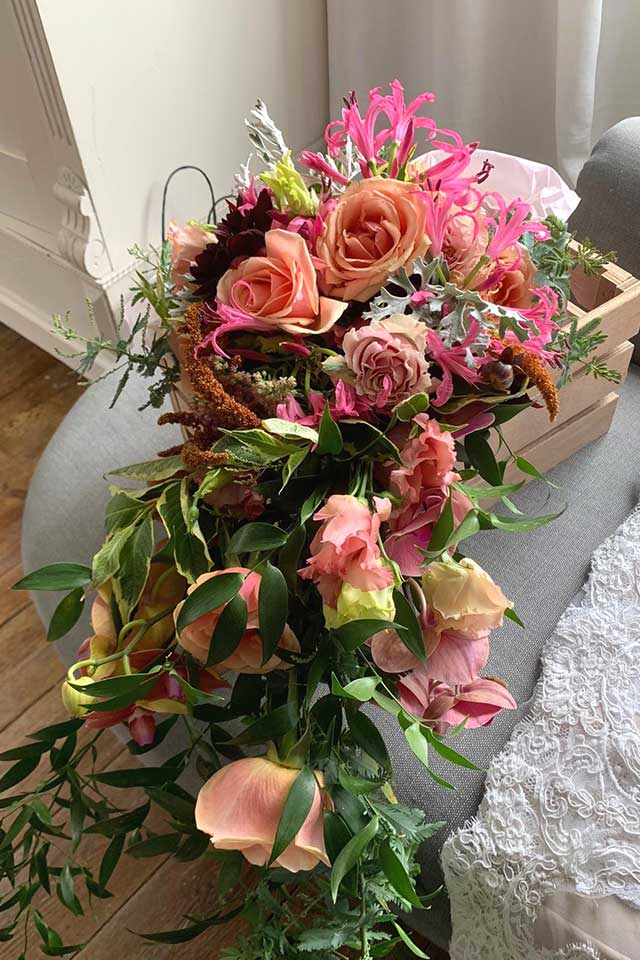 vibrant pink and orange wedding flowers for Indian fusion wedding