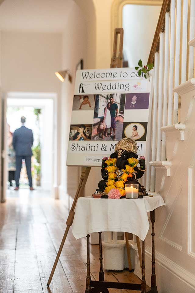 wedding entrance sign with Ganesha and candles