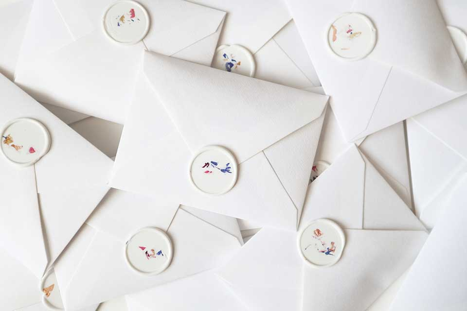 white envelopes sealed with wax seal petal confetti