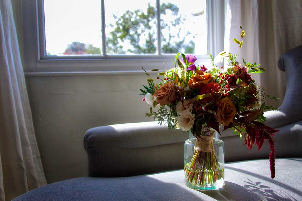 glass vase with autumn wedding flowers bouquet