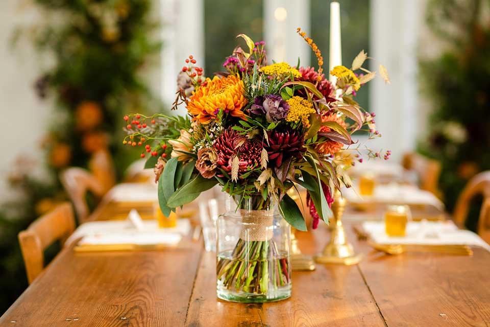 autumn wedding flowers in vase on wedding table