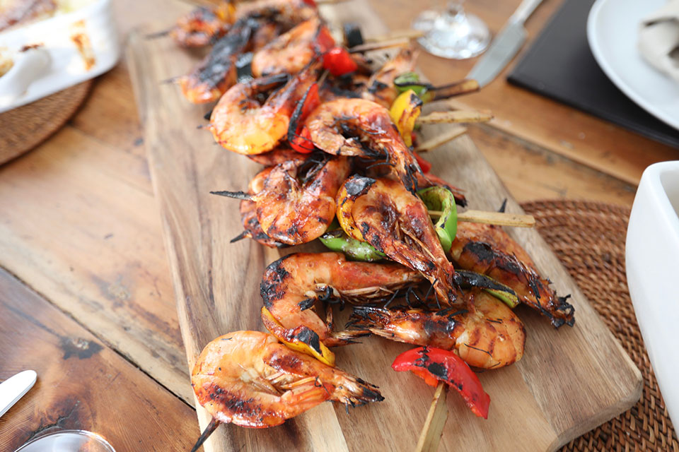 barbeque prawns on wooden platter for relaxed wedding meal