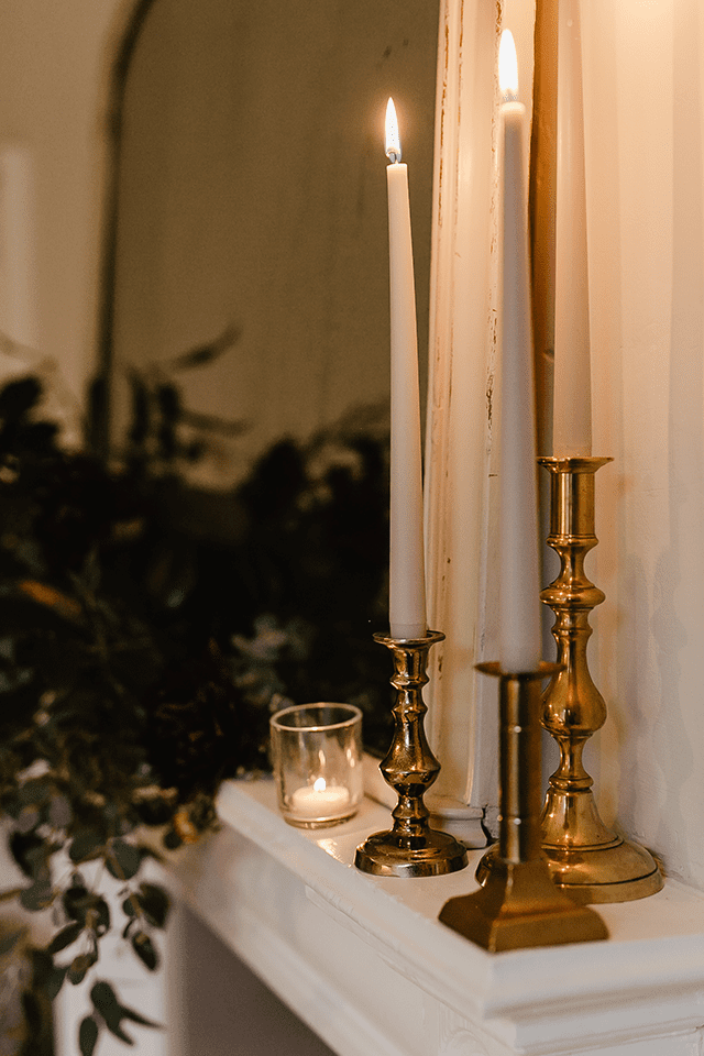 Brass candlesticks on mantelpiece
