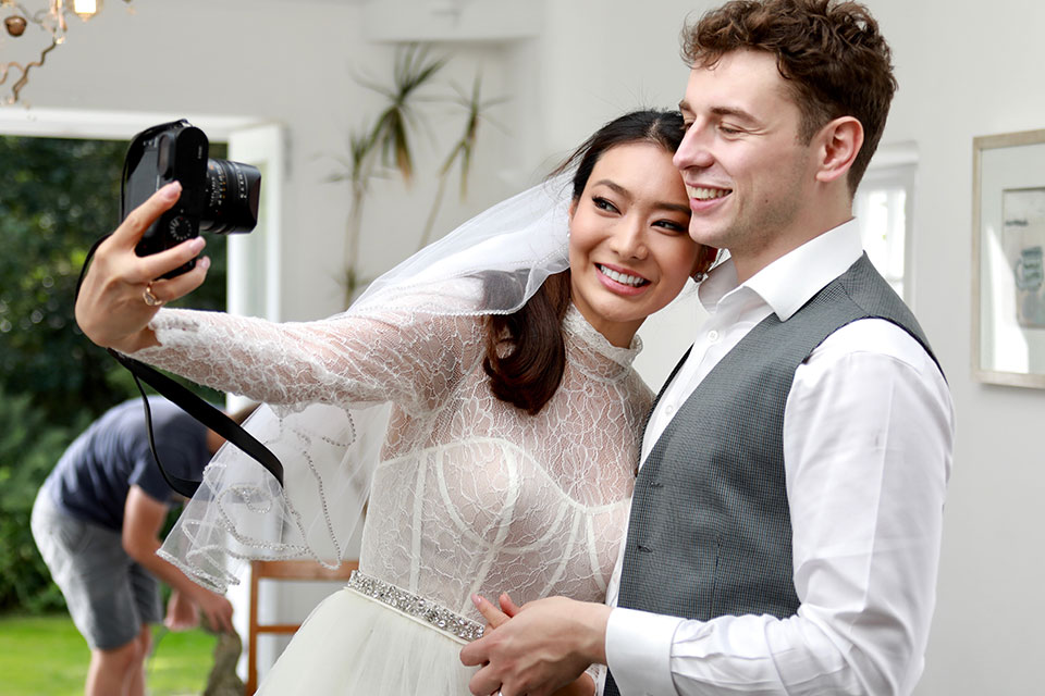 Bride and groom taking a selfie on their wedding day