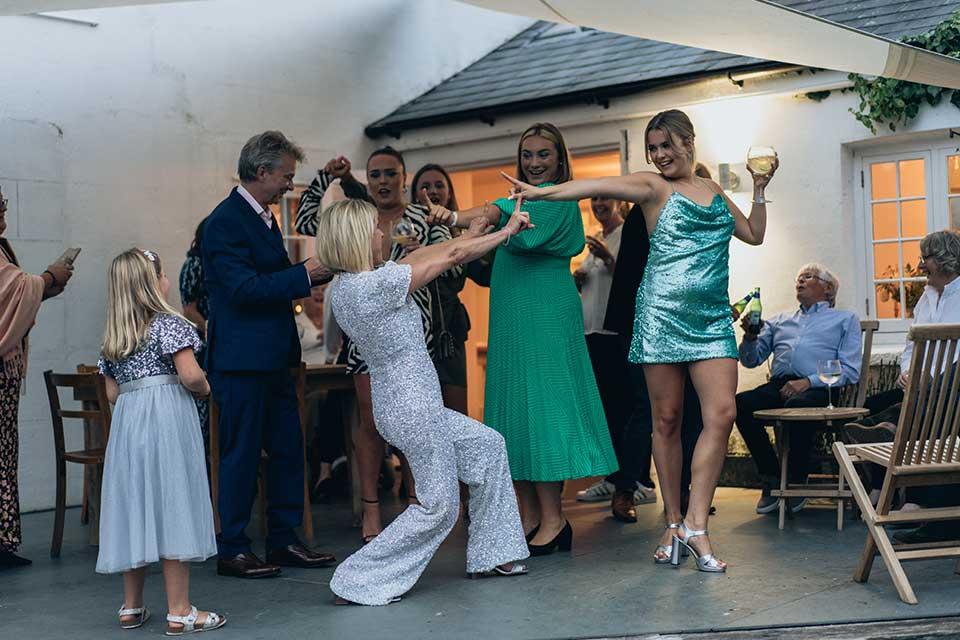 bride and guests having fun dancing at a small wedding