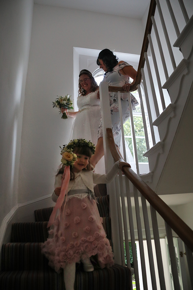 Bride and bridesmaids walking down Georgian staircase