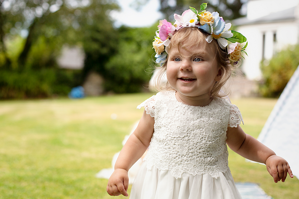 bridesmaid wearing flower crown at small Cornwall garden wedding