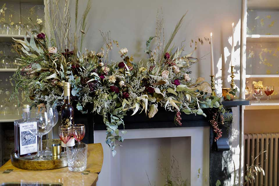 Cocktail bar with flower arrangement