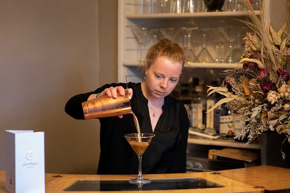 Person pouring cocktail