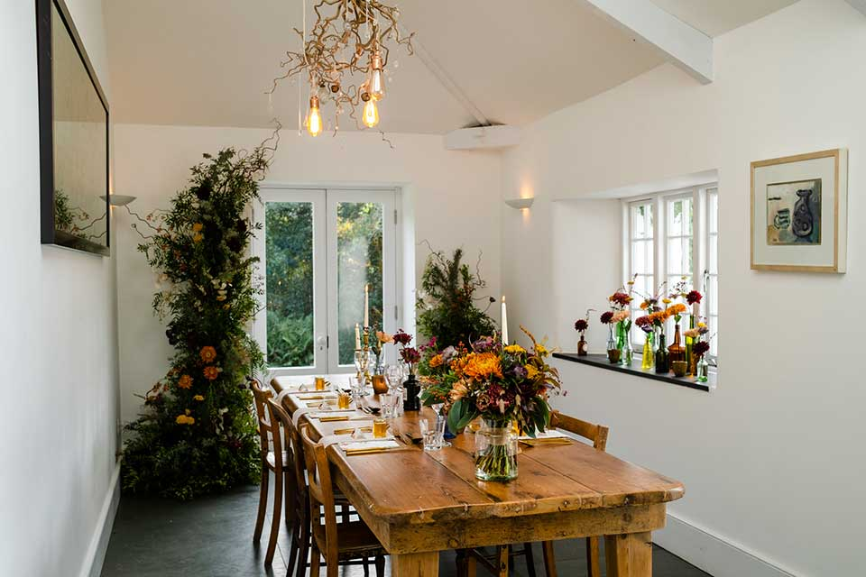 wedding table setup for meal with autumn floral display