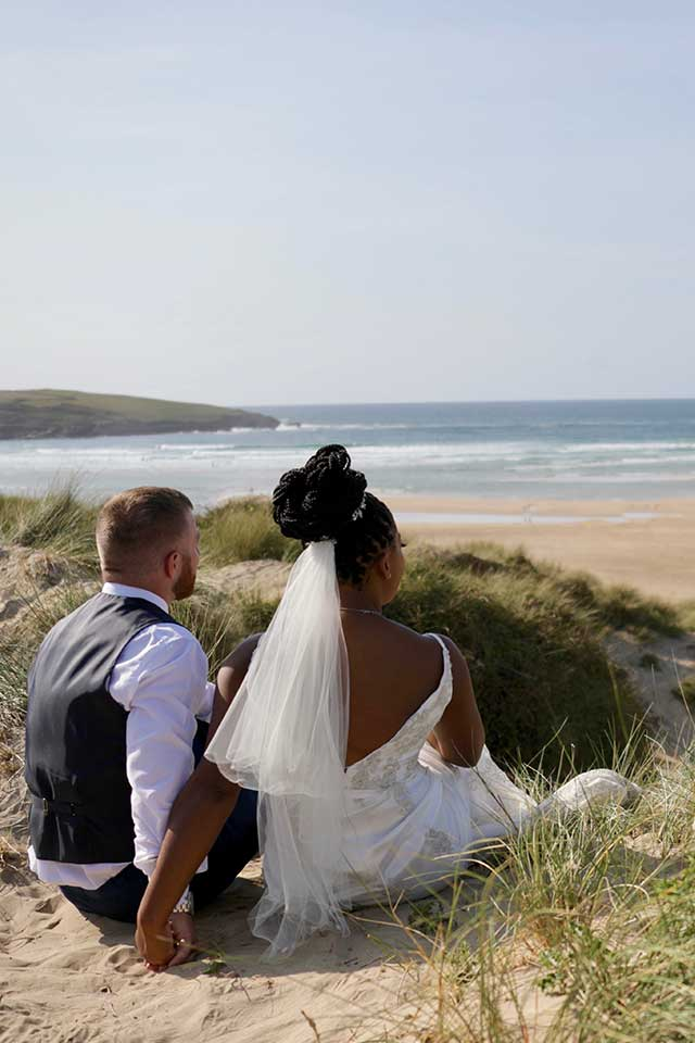 elopement wedding photograph of couple on Holywell Bay