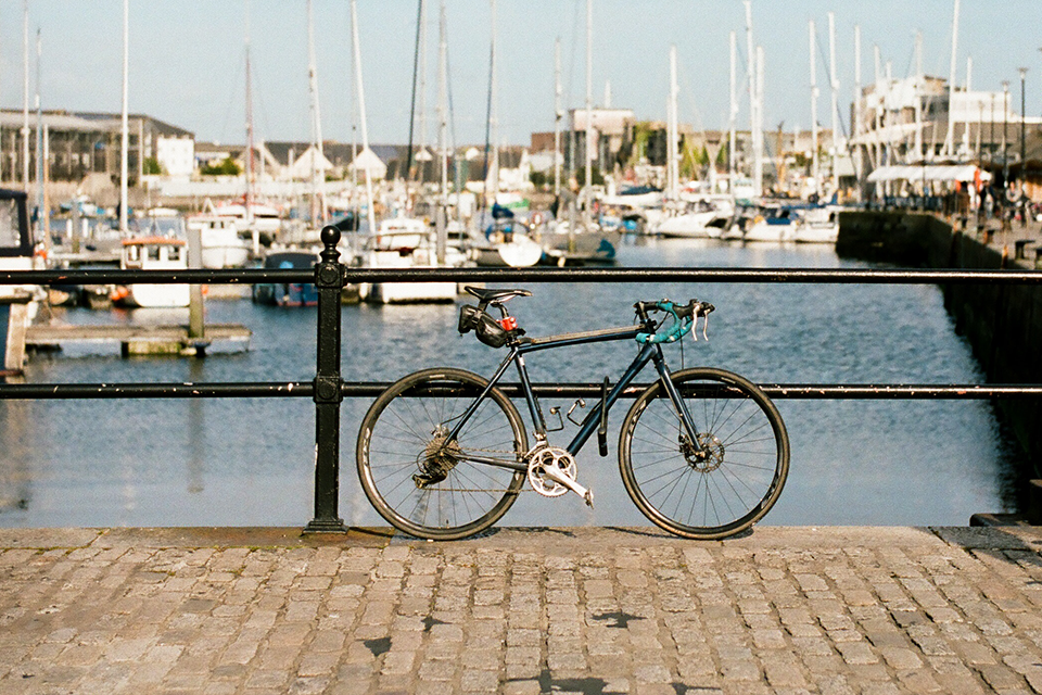 bike leaning against railings in sea harbour