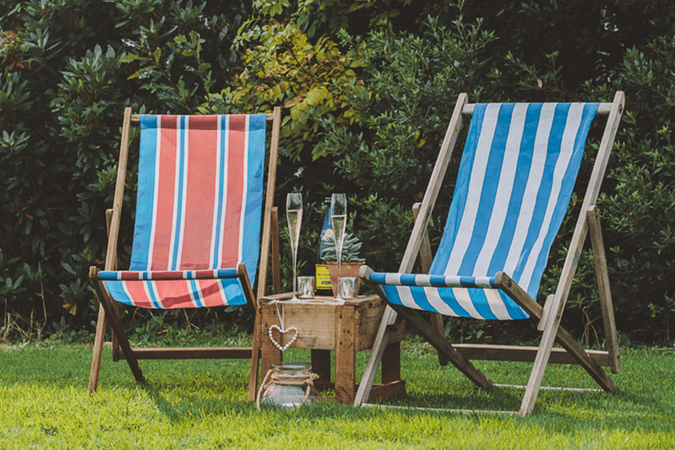 striped deckchairs on green lawn