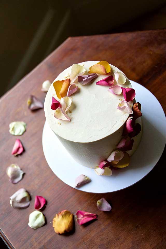 elegant small wedding cake with autumn flowers petals