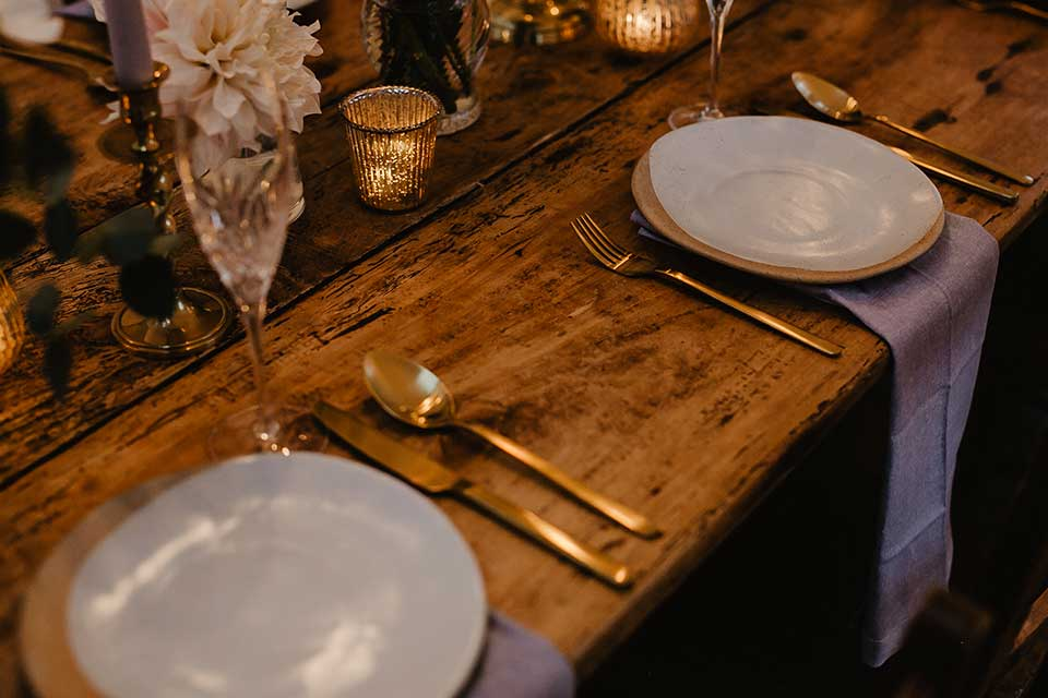 elopement wedding table setting with gold cutlery and salt glaze pottery