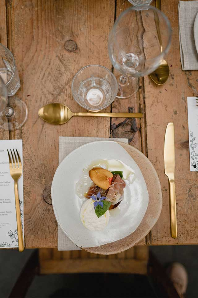 fine dining wedding meal served on salt glaze crockery with gold cutlery
