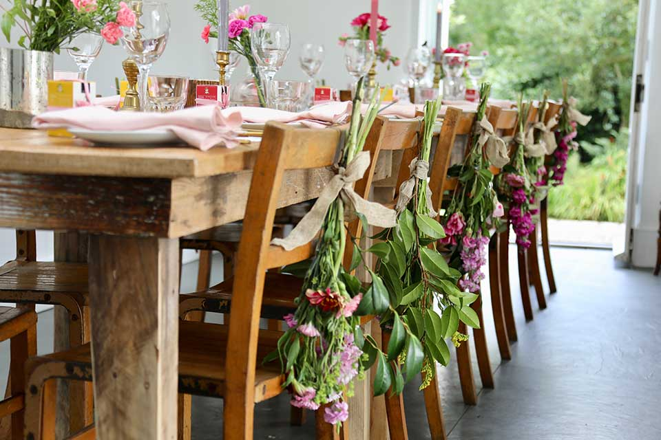 summer wedding table setting with floral chair tie backs